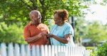 happy-older-couple-outside-in-front-of-picket-fence_573x300.jpg